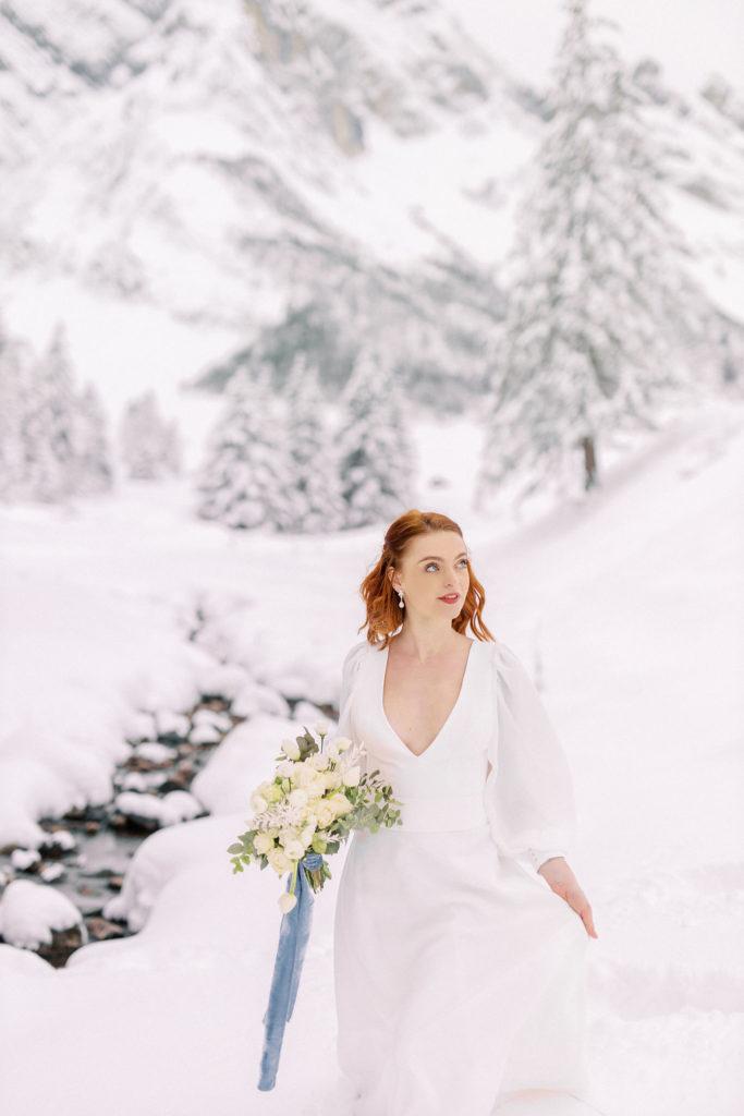 Snow bride, bride with her bouquet, winter wedding, winter wedding dress