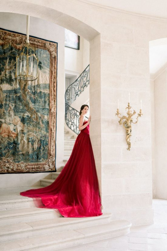 Bride with her red wedding dress at the chateau de villette in paris